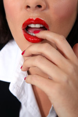 Businesswoman with red lips and nails
