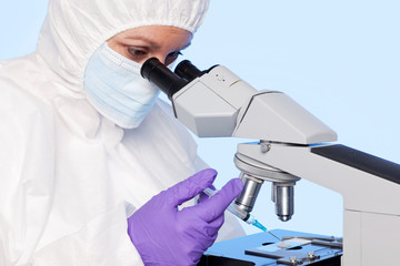 Embryologist extracting a sample using a syringe.