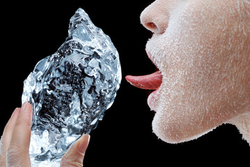 Woman licking block of ice.