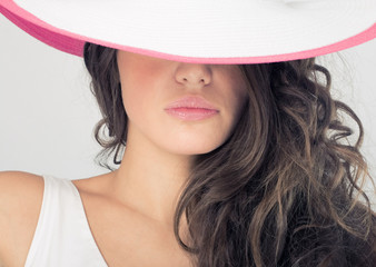 Fashion photos delightful woman in a white hat