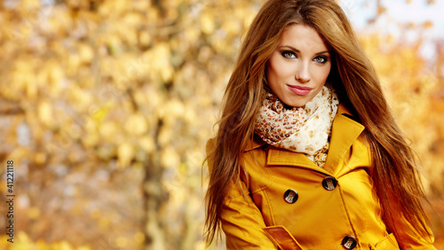 Beautiful elegant womanin autumn park