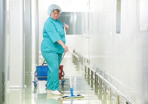 Leinwanddruck Bild Woman cleaning hospital hall