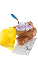 Hausbau, Finanzierung, Bausparen. Ziegel und Euro