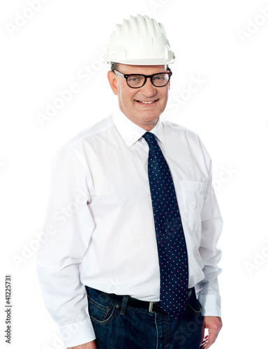 Handsome smiling aged engineer with hard hat
