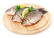 Fresh fishes with lemon and parsley