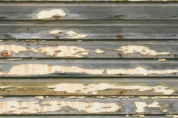 Yellow Peeling White Paint on old Siding