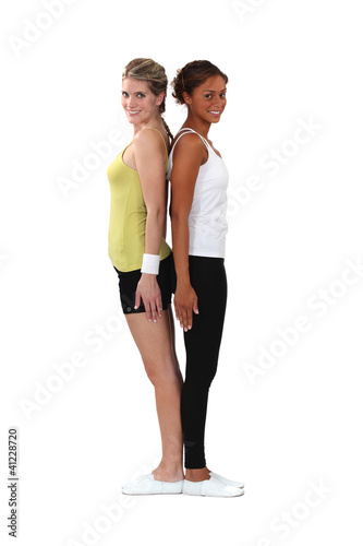 Two female gymnasts stood back to back