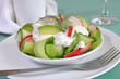Cucumber salad with radish and avocado cream sauce