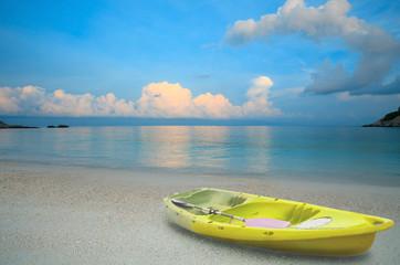 yellow sea kayak on sand beach