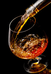 The glass with splashes cognac