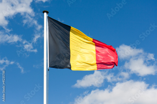 Belgium flag over a blue sky