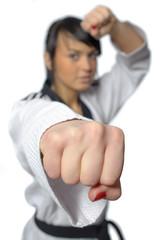 Taekwondo. Woman in a kimono on the white background