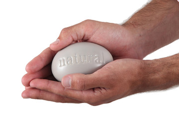 Man holding large pebble