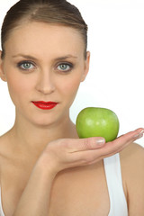 graceful ballerina with bright red lipstick holding green apple