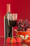 Red wine bottle and fruit with glass - 41240553