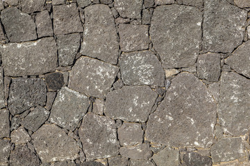 wall made seamless from volcanic stone