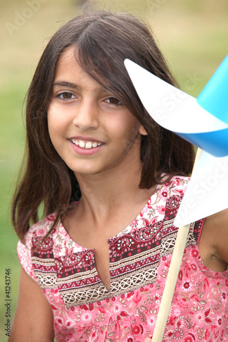 Little girl playing with windmill