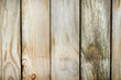 Old fence made ​​of weathered boards