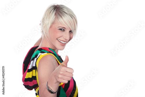 canvas print picture Beauty blonde Frau lacht und hält Daumen hoch