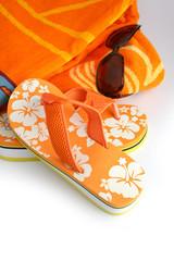Flip-flops, sunglasses and towel