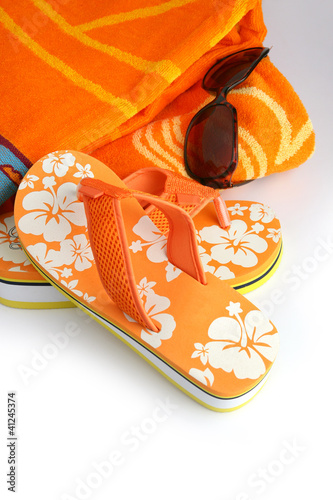 Flip-flops, sunglasses and towel
