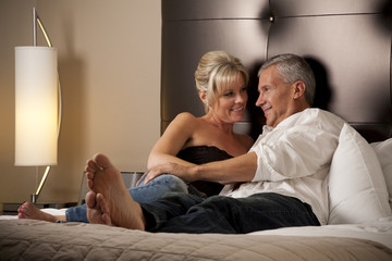 Man Talking with a Woman Relaxing in Hotel Room
