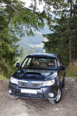 Subaru Forester on the off road track in mountains