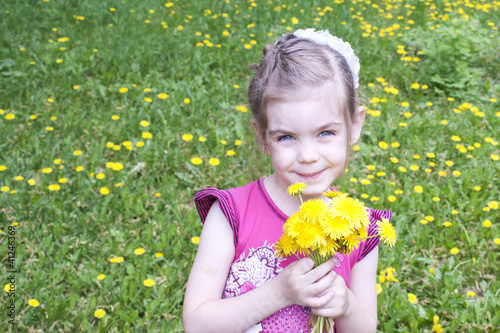Young girl in a field of dandelions