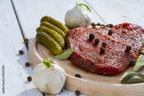 Seasoned steak ready to grill