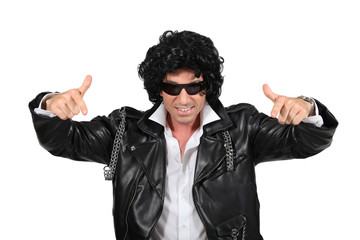 Man in a black wig and leather biker jacket