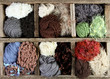 many autumn colored yarns in wooden box