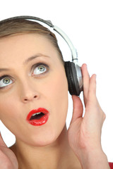 Blond woman with headphones audio