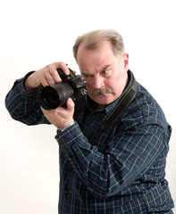 man photographer doing photos by digital camera isolated