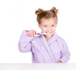 Cute little girl brushing teeth