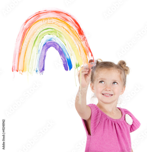 Little girl paints rainbow on window