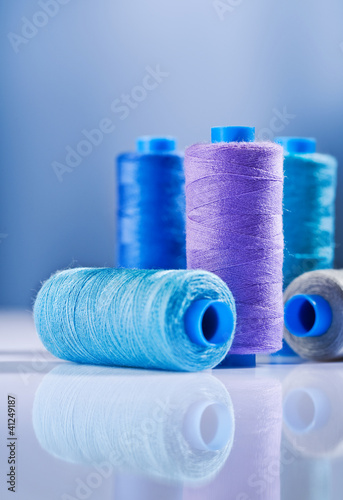 five sewing spools