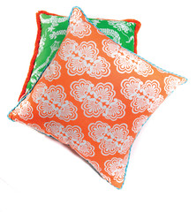 Bright orange and green pillows isolated on white background