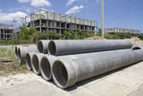 asbestos pipes for drian in construction site
