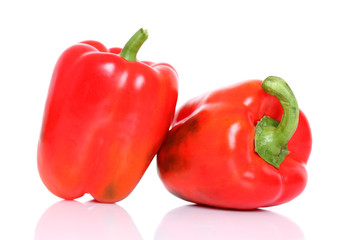 Red bell peppers isolated on white