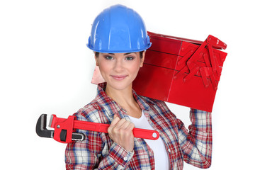 Woman carrying tool box on shoulder