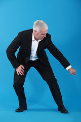 Businessman pulling an imaginary object