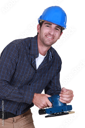 Workman with an electric sander