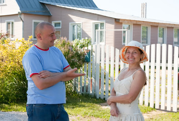man and woman infront of his house