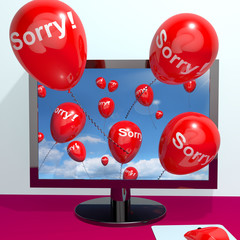 Sorry Balloons From Computer Showing Online Apology Regret Or Re