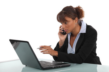 Young businesswoman multitasking