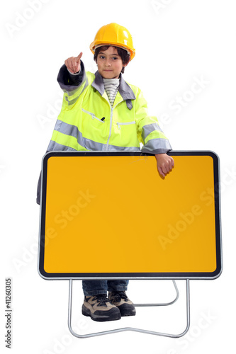 Little boy dressed as highway maintenance