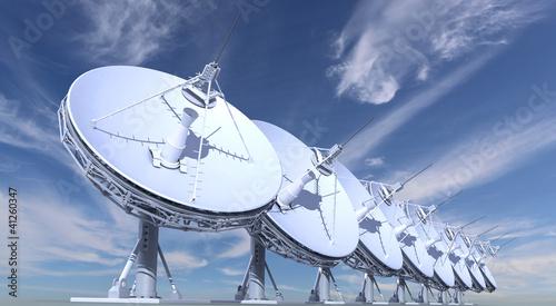 Leinwanddruck Bild radio telescopes on sky background