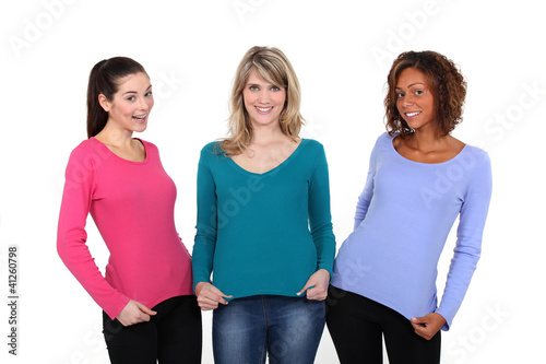 Three women displaying jumpers