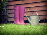 boots with can in garden
