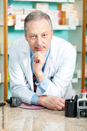 Portrait of a pharmacist in his store